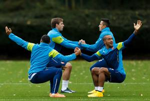 Alex Oxlade-Chamberlain, Nacho Monreal, Alexis Sanchez and Theo Walcott warm up before a training session ahead of Arsenal's Champions League clash with Anderlecht. Photo: John Walton/PA Wire