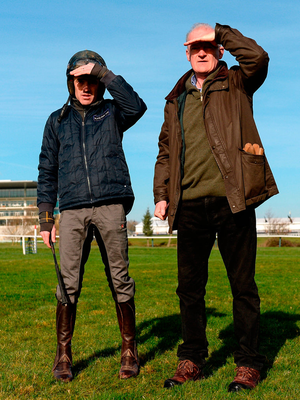 Ruby Walsh and Willie Mullins keep a close eye on the action on the gallops at Cheltenham yesterday. Photo: Sportsfile