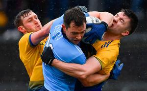 UNDER PRESSURE: Dean Rock of Dublin is tackled by Conor Devaney (left) and Conor Daly of Roscommon during the Allianz Football League Division 1 match at Dr Hyde Park. Photo: Ramsey Cardy/Sportsfile