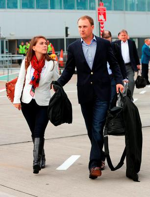 Jordan Spieth of the United States and girlfriend Annie Verret arrive at Edinburgh Airport ahead of the 2014 Ryder Cup at Gleneagles