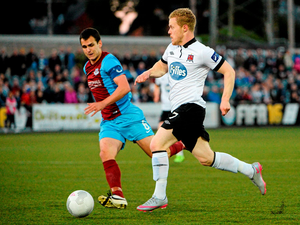 Dundalk's Daryl Horgan in action against Mick Daly, Drogheda United