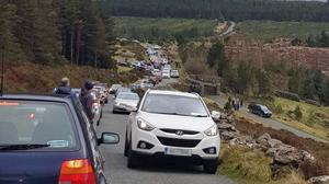 Avoid the crowds: Busy scenes near Lough Tay, Co Wicklow, people look for a distraction from the coronavirus crisis and home. Photo: @LugMoquilla