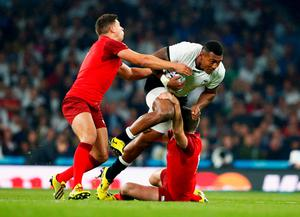 Ben Youngs (L) and George Ford of England tackle Waisea Nayacalevu of Fiji during their 2015 Rugby World Cup match.  Photo by Shaun Botterill/Getty Images