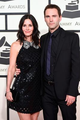 Courteney Cox (L) and songwriter Johnny McDaid attend The 57th Annual GRAMMY Awards at the STAPLES Center on February 8, 2015 in Los Angeles, California.  (Photo by Jason Merritt/Getty Images)
