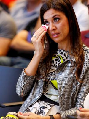 Wife Nuria Cunillera reacts as Barcelona's Xavi Hernandez announces her pregnancy during his farewell event