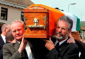 Sinn Fein President Gerry Adams (right) and Martin McGuinness carrying the coffin of former senior IRA commander Brian Keenan in west Belfast. Photo: Paul Faith/PA Wire