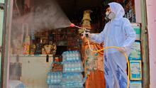A Yemeni sanitation worker, wearing protective gear, sprays disinfectant in a neighbourhood in the northern Hajjah province during the ongoing coronavirus pandemic. (Photo by ESSA AHMED/AFP via Getty Images)