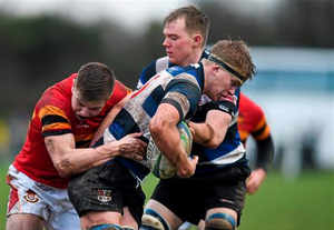 28 January: Sean Naughton, Crescent College, is tackled by Alex McHenry,SEAT Munster Schools Senior Cup, Round 1, Crescent College v CBC at Tom Clifford Park, Limerick (Diarmuid Greene / SPORTSFILE)