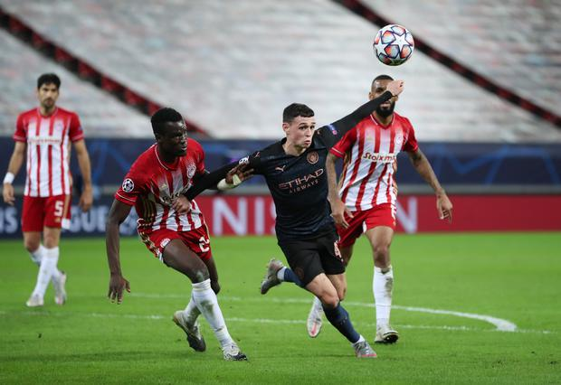 Manchester City's Phil Foden in action against Olympiacos' Ousseynou Ba during their Champions League Group C clash at the Karaiskakis Stadium, Piraeus, Greece. Phoro: Reuters/Alkis Konstantinidis