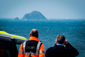 Rescuers look out towards Blackrock island. Photo: Keith Heneghan / Phocus