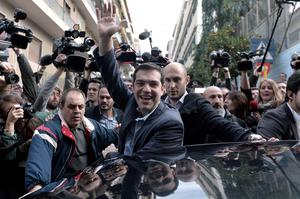 ALEXIS Tsipras, leader of the anti-austerity Syriza party, waves to supporters after casting his vote in Athens for the Greek general election.