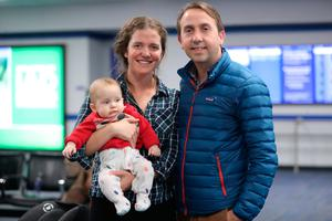 Shows cancelled: Musician Oisín MacDiarmada and wife Samantha Harvey, with baby Finnan, waiting for a flight out of Washington. Photo: Niall Carson/PA Wire