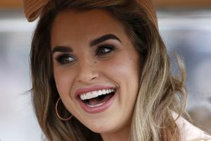 Vogue Williams poses at Punchestown racecourse on April 28, 2017 in Naas, Ireland. (Photo by Alan Crowhurst/Getty Images)