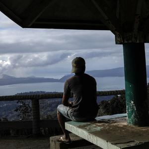 A man looks at the errupting Taal Volcano from a park in Tagaytay City, Philippines, January 14, 2020. REUTERS/Eloisa Lopez