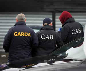 Gardai and the Criminal Assets Bureau have cracked down on the so-called 'Tarmac Gang' after they conned homeowners