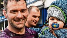 Fergus McFadden with son Freddy after Leinster's win over the Cheetahs in Feburary, which looks like being his last game for the province. Photo: Ramsey Cardy/Sportsfile