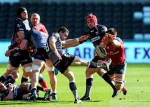 Munster's Billy Holland charges down Tom Habberfield, Ospreys