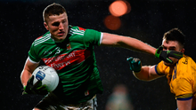 Brian Reape of Mayo in action against Evan McGrath of Roscommon