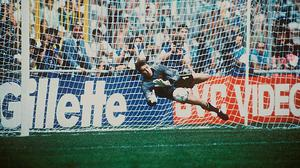 Packie Bonner saves Romania's Daniel Timofte's shot during the penalty shoot-out in 1990 Genoa, Italy. Picture credit: SPORTSFILE