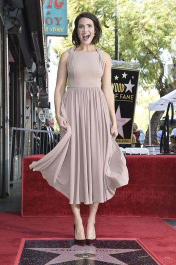 Mandy Moore poses for photographers at a ceremony honouring her with a star on the Hollywood Walk of Fame (Richard Shotwell/Invision/AP)