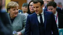 Germany's Chancellor Angela Merkel and France's President Emmanuel Macron speak as they walk after a bilateral meeting on the second day of the European Union leaders summit, held to discuss the EU's long-term budget for 2021-2027, in Brussels, Belgium, February 21, 2020. Kenzo Tribouillard/Pool via REUTERS