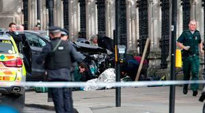 Police close to the Palace of Westminster, London, after policeman has been stabbed and his apparent attacker shot by officers in a major security incident at the Houses of Parliament: Yui Mok/PA Wire