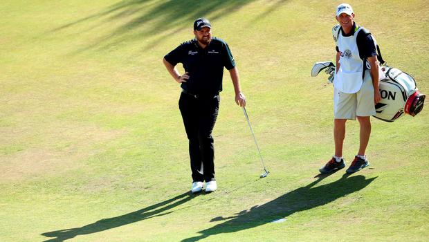 UNIVERSITY PLACE, WA - JUNE 20: Shane Lowry of Ireland and caddie Dermot Byrne wait on the 12th hole during the third round of the 115th U.S. Open Championship at Chambers Bay on June 20, 2015 in University Place, Washington.  (Photo by Andrew Redington/Getty Images)