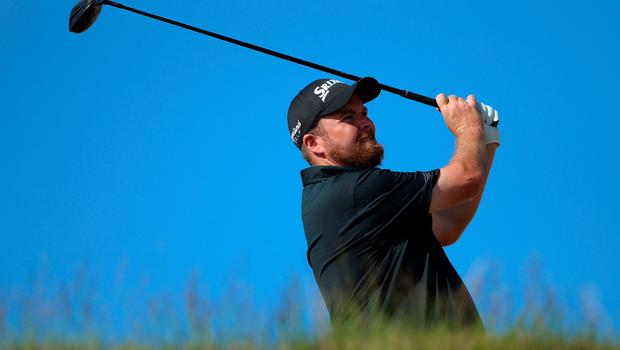 UNIVERSITY PLACE, WA - JUNE 20:  Shane Lowry of Ireland hits his tee shot on the 16th hole during the third round of the 115th U.S. Open Championship at Chambers Bay on June 20, 2015 in University Place, Washington.  (Photo by Andrew Redington/Getty Images)