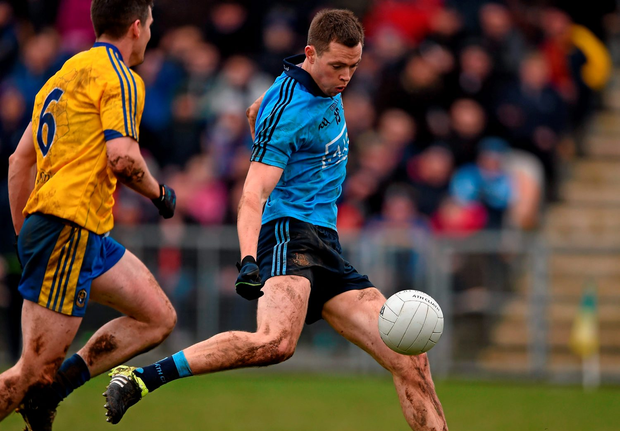 Dean Rock shrugs off the attentions of Roscommon's Sean Purcell to fire home Dublin's goal in Carrick-on-Shannon yesterday. Photo: Sportsfile