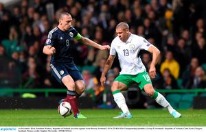 Jonathan Walters, Republic of Ireland, in action against Scott Brown, Scotland. UEFA EURO 2016 Championship Qualifier, Group D, Scotland v Republic of Ireland, Celtic Park, Glasgow, Scotland. Picture credit: Stephen McCarthy / SPORTSFILE
