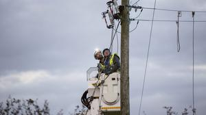 ESB workers restoring power to a farm in Glamire, Cork after Hurricane Ophelia Pic:Mark Condren