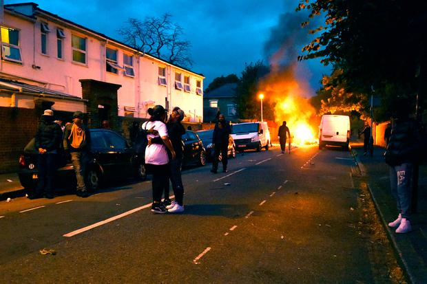 Campaigners face off with police in Richmond Road in Forest Gate, north east London