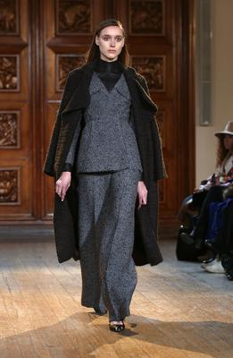 LONDON, ENGLAND - FEBRUARY 15:  A model walks the runway at the Emilia Wickstead show at London Fashion Week AW14 at Royal Institute of British Architects on February 15, 2014 in London, England.  (Photo by Tim P. Whitby/Getty Images)