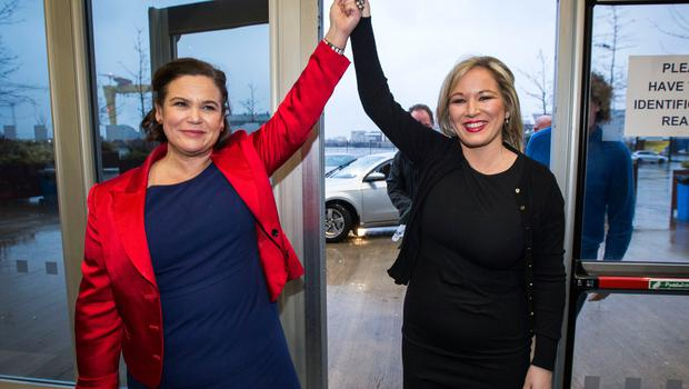 Sinn Fein Deputy President Mary Lou McDonald TD (left) rises the hand of Sinn Fein Leader in the North Michelle O'Neill as she arrives at the Titanic Exhibition Centre, Belfast for the 2017 Northern Ireland Assembly election count. Photo: Liam McBurney/PA Wire