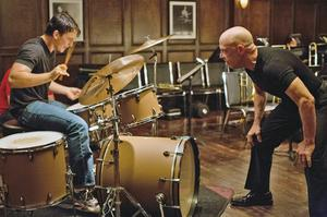 Left to right: Miles Teller as Andrew and J.K. Simmons as Fletcher in Whiplash.  Photo by Daniel McFadden, Courtesy of Sony Pictures Classics
