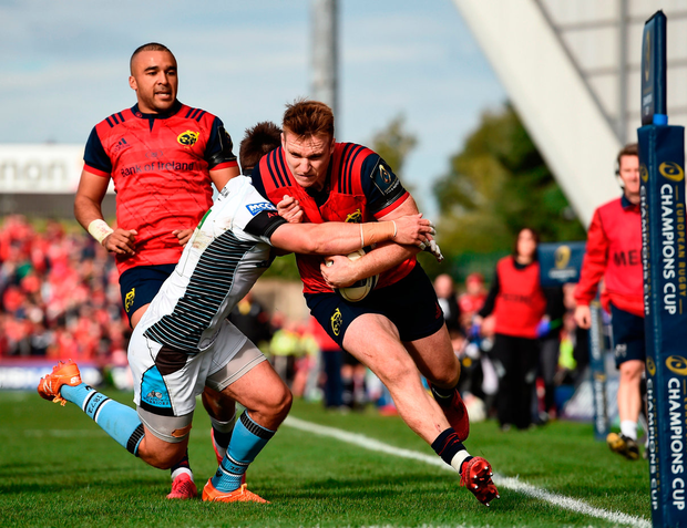 Munster's Rory Scannell beats the tackle of Ali Price on the way to scoring his side's fifth try against Glasgow. Picture by Brendan Moran. Photo by Brendan Moran/Sportsfile