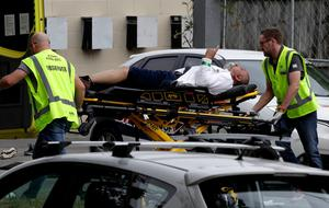 Ambulance staff take a man from outside a mosque in central Christchurch, New Zealand. Photo: Mark Baker/AP