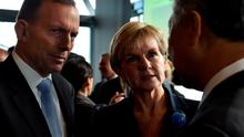 This picture taken on June 11, 2015 shows Australian Foreign Minister Julie Bishop (C) and Australian Prime Minister Tony Abbott (L) meeting with delegates at the Regional Countering Violent Extremism Summit in Sydney.  Bishop on June 15, 2015 told Indonesia to better secure its borders in a stinging rebuke after Jakarta demanded answers to allegations Canberra paid to turn back a boat of asylum-seekers. AFP PHOTO / Saeed KHANSAEED KHAN/AFP/Getty Images