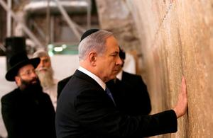 Israel's Prime Minister Benjamin Netanyahu touches the stones of the Western Wall, Judaism's holiest prayer site, in Jerusalem's Old City. Reuters