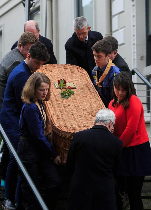 Respect: The coffin of Cormac Ó Braonáin is carried from the Mansion House. Picture: Gareth Chaney