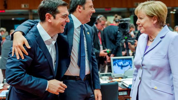 Greek Prime Minister Alexis Tsipras, left, and Italian Prime Minister Matteo Renzi speak with German Chancellor Angela Merkel during a round table meeting at an EU summit in Brussels on Thursday, June 25, 2015. Greece and its creditors launched a new round of talks in Brussels early Thursday in a fresh bid to unlock billions of euros in loans and save the country from bankruptcy. (AP Photo/Geert Vanden Wijngaert)