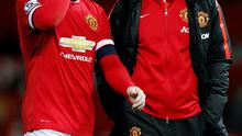 Manchester United's Wayne Rooney looks dejected after the match with assistant manager Ryan Giggs