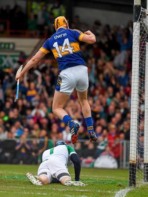 21 June 2015; Seamus Callanan jumps out over the Limerick goalkeeper Barry Hennessy as he celebrates scoring the second tipperary goal in the 22nd minute.  Munster GAA Hurling Senior Championship, Semi-Final, Limerick v Tipperary, Gaelic Grounds, Limerick. Picture credit: Ray McManus / SPORTSFILE