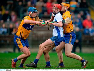 Callum Lyons of Waterford in action against Bobby Duggan, left, and Conor O'Donnell of Clare