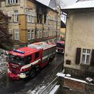 A firetruck is seen parked next to a building affected by fire, in Vejprty, Czech Republic January 19, 2020 in this picture obtained from social media. David Dvoracek/via REUTERS