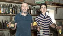 Pat Doyle with Aidan Ryan, who works at the pub, in one of the lofts where the bottles were stored