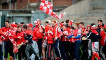 Cuala supporters and players celebrate at the end of their semi-final victory over Slaughtneil. Photo: Oliver McVeigh/Sportsfile