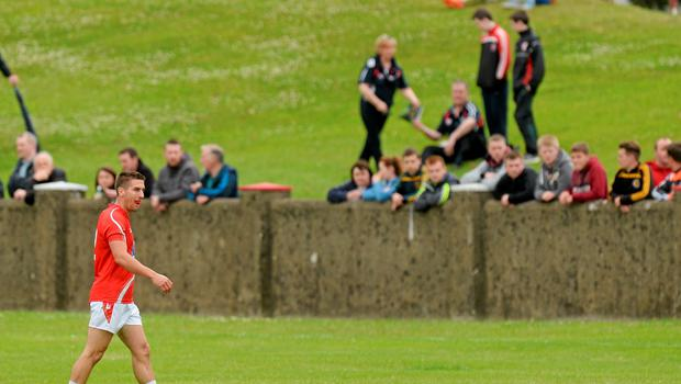 27 June 2015; Pádraig Rath, Louth, leaves the field after being shown the black card by referee Ciarán Branagan. GAA Football All-Ireland Senior Championship, Round 1B, Louth v Leitrim. County Grounds, Drogheda, Co. Louth. Picture credit: Piaras Ó Mídheach / SPORTSFILE