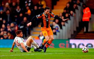 Fulham's Tomas Kalas brings down Hull City's Andrew Robertson to concede a penalty. Photo credit: Paul Harding/PA Wire