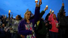 Local residents attend a candlelight vigil in the Dorchester neighborhood of Boston, where eight-year-old Boston Marathon explosion victim Martin Richard lived.